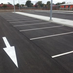 Directional arrows and car park line marking