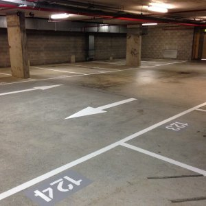 Parking bay with traffic flow arrows