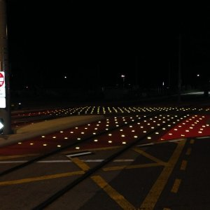 Road sign markings and reflectors